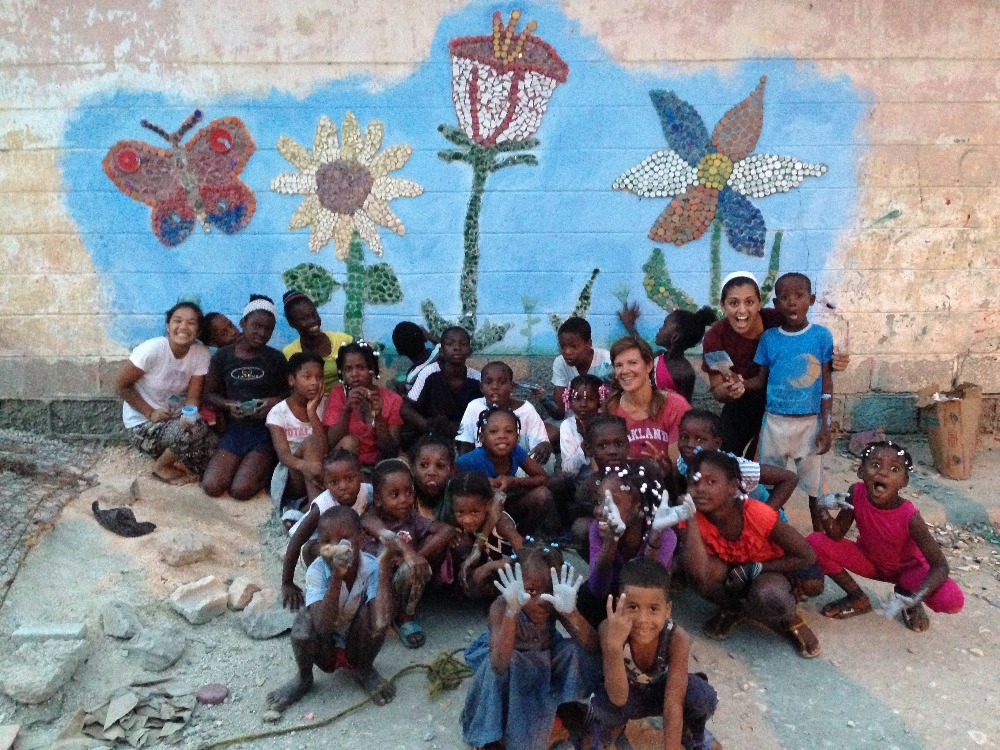 group photo in front of the new mosaic mural